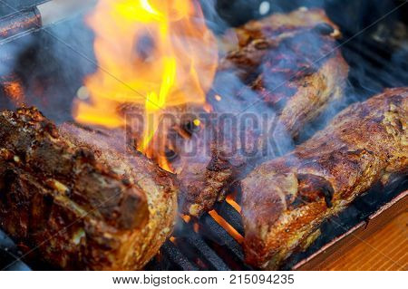 Grilling Baby Back Pork Ribs Over Flaming Grill