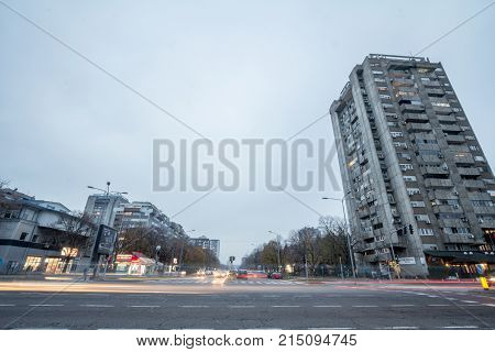 BELGRADE SERBIA - NOVEMBER 19 2017: Street in New Belgrade with tall residential buildings aging from the communist period built on the side. New Belgrade or Novi Belgrade is the part of the city built during Socialist Yugoslavia
