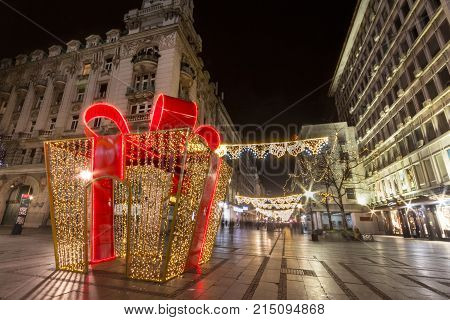 BELGRADE SERBIA - NOVEMBER 19 2017: Giant gift wrap used as the main Christmas decoration on Kneza Mihailova main street of Belgrade illuminated for Xmas and the new year