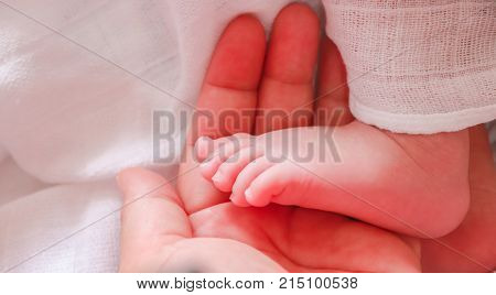baby hand in mom's hand whilst asleep