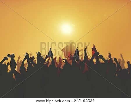 Silhouette of a music concert at sunset