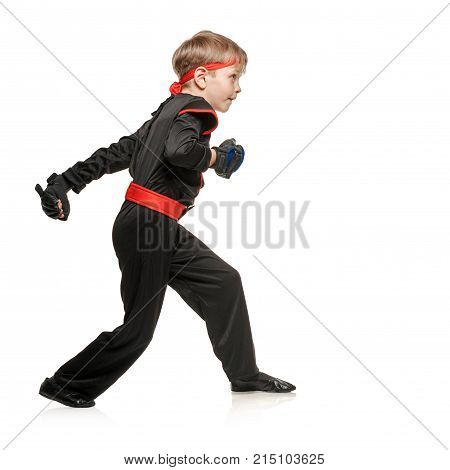 Little boy in kimono doing martial arts exercises. Cosplay hero ninja poster