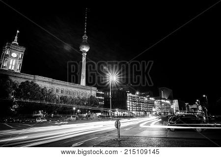 BERLIN - OCTOBER 08 2017: Downtown in the night lights. In the background the Berlin TV Tower (Fernsehturm) and the Red Town Hall (Rotes Rathaus). Black and white.