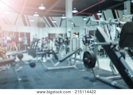 abstract blur fitness room with equipment and sportswear background. image for sport hobbie building indoors healthy concept