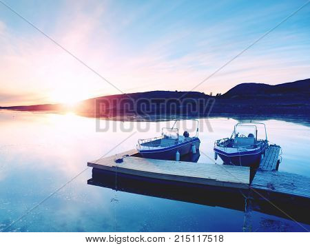 Motorboat For Sport Fishing Tied To A Wooden Floating Dock. Fishing Boat In Bay Port,