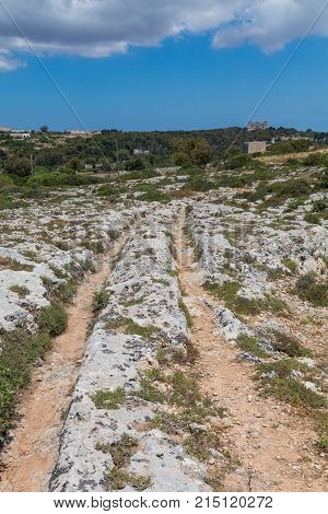 Mysterious ancient cart ruts at Misrah Ghar il-Kbir aka Clapham Junction, a prehistoric site near the Dingli Cliffs, Siggiewi, Malta poster