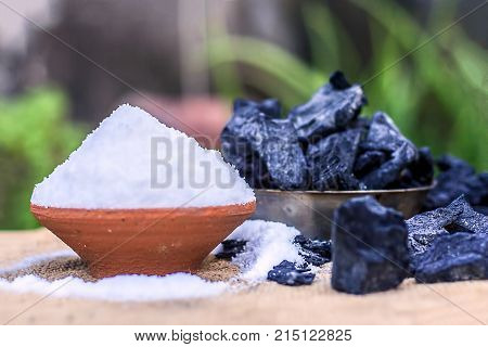 Sodium Chloride,salt In A Clay Bowl With Coal.