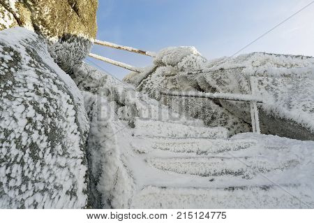 Dreisessel - ice covered stairs to top. Winter landscape with rocks in Sumava Czech republic