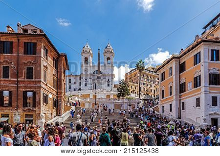 ROME - AUGUST 11, 2017: The Spanish Steps, the monumental stairway of 135 steps designed by architects Francesco de Sanctis and Alessandro Specchi links Piazza di Spagna with Piazza Trinita dei Monti.
