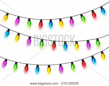 Christmas glowing lights on white background. Garlands with colored bulbs. Xmas holidays. Christmas greeting card design element. New year, winter.