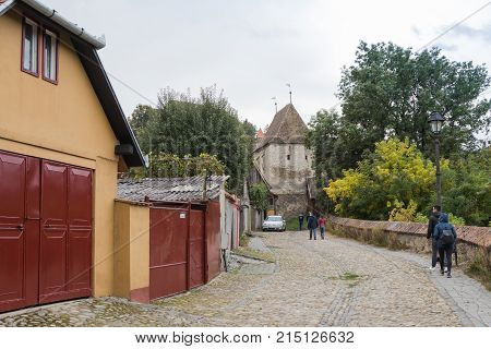 Sighisoara Romania October 08 2017 : Tourists walk along the quiet streets of the old city and visit the sights in Sighisoara city in Romania