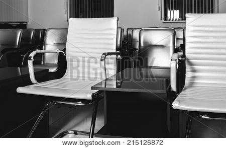 bright stylish armchairs in an empty hall for performances.