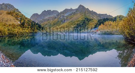 Morning mist on the Kardyvach lake. Caucasian Biosphere Reserve