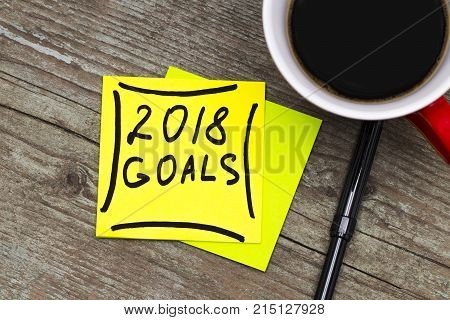 2018 Goals - Handwriting In Black Ink On A Sticky Note With A Cup Of Coffee, New Year Resolutions Co