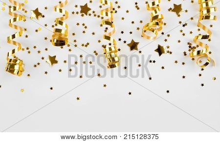 Gold stars confetti and curled ribbons isolated on white background