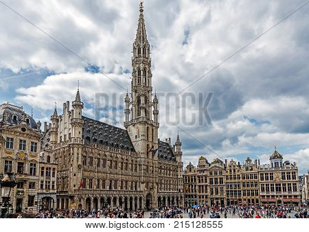 BRUSSELS - JUNE 16, 2017: Historic Town Hall in the Grand Place, place is UNESCO World Heritage Site and main attraction of the city, full of tourists 24 hours a day.