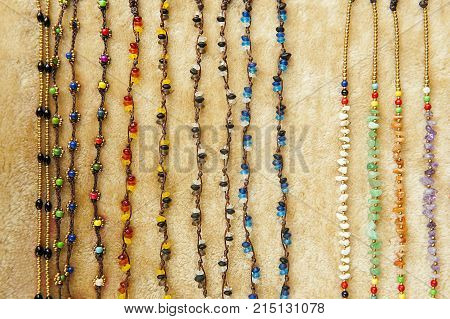 Background and texture of bracelet full of colorful bead. Handicrafts bracelet in store.