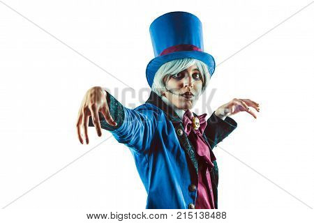 Sad Gesticulating Circus Actor In Blue Tuxedo. Isolated On White Background.