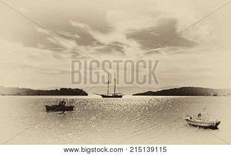 Fishing and sailing boats in the bay. Fine art image canvas texture added.Sepia tone.