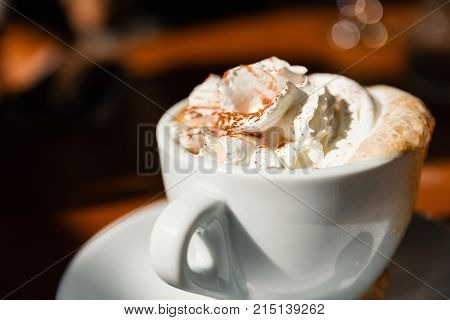 Cup Of Cappuccino With Fresh Whipped Cream And Cinnamon On Top