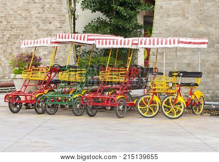 Bicycle with four wheels on the square