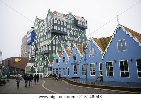 ZAANSTAD NETHERLANDS - NOVEMBER 13 2016: Typical facade of the Inntel hotel opened in 2010. It is an accumulation of almost seventy separate Zaanse houses executed in four colors Zaans green.