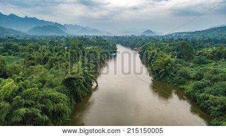 Aerial evening shot of Kwai Noi river in Kanchanaburi, Thailand