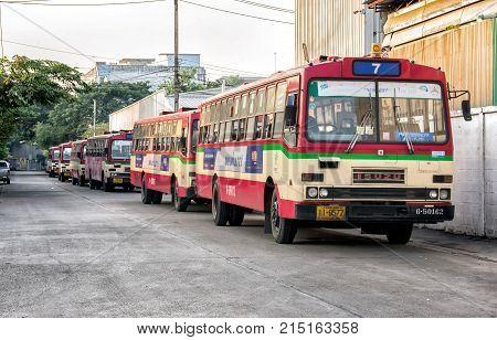 BANGKOK THAILAND - NOVEMBER 14: Rundown free fare buses by Bangkok Mass Transit Authority lined up in the morning before daily operation in Bangkok on November 14 2017.