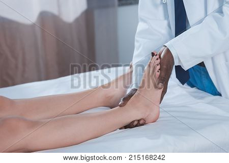 Doctor Examining Patient Ankle