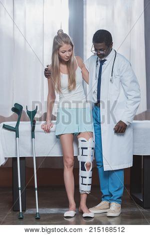 Doctor Helping Patient Stand Up