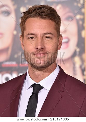 "LOS ANGELES - OCT 30:  Justin Hartley arrives for the ""A Bad Moms Christmas"" Los Angeles Premiere on October 30, 2017 in Westwood, CA"