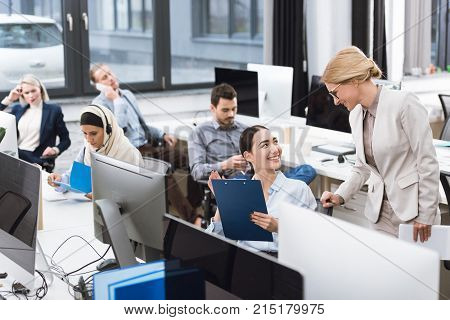selective focus of group of multiethnic businesspeople working in office