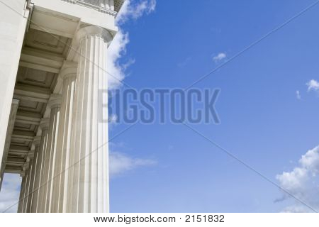 Stone Columns With Portico Roof Viewed From The Right Side With Blue Sky Area For Your Text