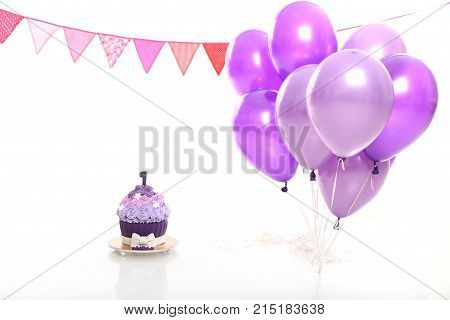 birthday cake and baloons on white background in the studio
