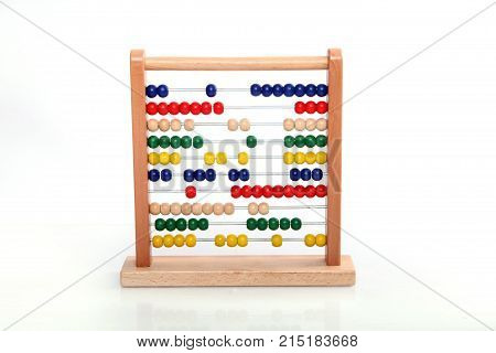 colorful abacus on white background in the studio