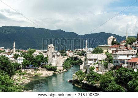 MOSTAR BOSNIA AND HERZEGOVINA - JULY 6 2008: Old Bridge of Mostar during a sunny afternoon. This bridge is the symbol of the war torn main city of Herzegovina
