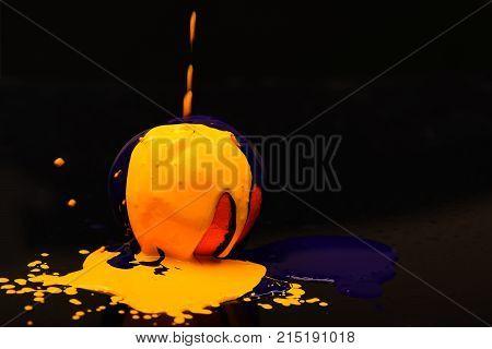 Paint Splashing On Orange Fruit. Orange Or Grapefruit