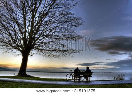Two men enjoy the sunset at Boulevard park in Bellingham, WA.