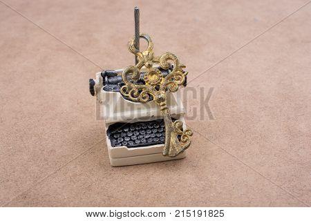 Retro Syled Tiny Typewriter Model On White Background