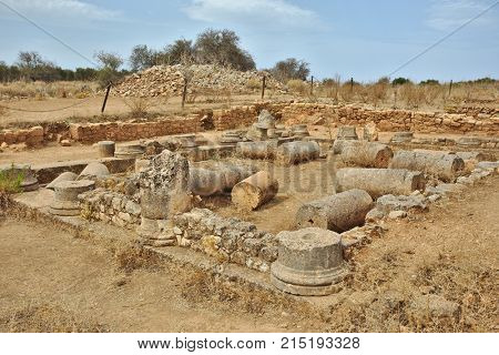 Tumbled columns of the house with the peristyle courtyard in Aptera, Crete, Greece, which was destroyed by earthquake in AD365