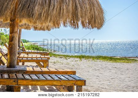 Palapa on the beach. Sky, sand and sea. Rest place to vacation.