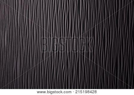 Wooden black undulating surface texture. Close up