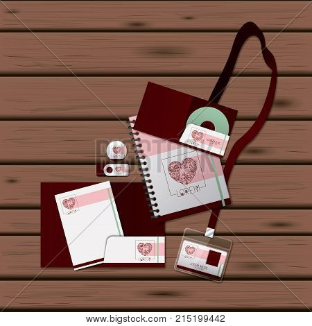 stationary templates of heart design of business stationery over dark wooden background vector illustration