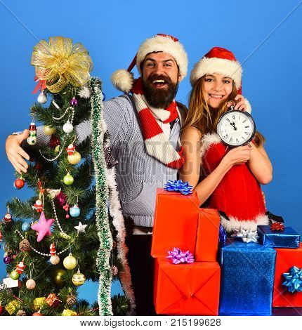 Santa And Sexy Girl With Clock And Gift Boxes