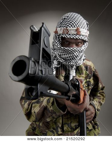 Portrait of serious eastern man with AK-47 aiming to you poster