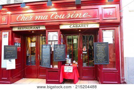 PARIS , France- November 22, 2017: View of typical paris cafe in Paris. Montmartre area is among most popular destinations in Paris, Chez ma cuisine is a typical cafe.
