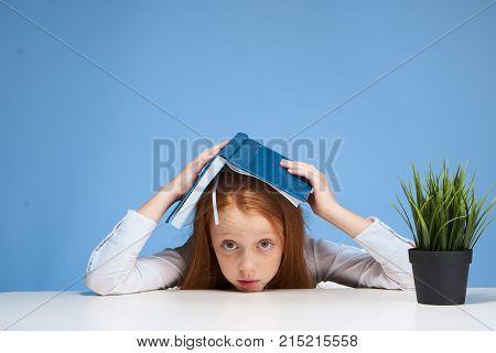 Little girl at the table, schoolgirl, study, child.