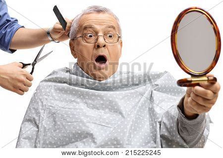 Shocked mature man having a haircut and looking at himself in a mirror isolated on white background