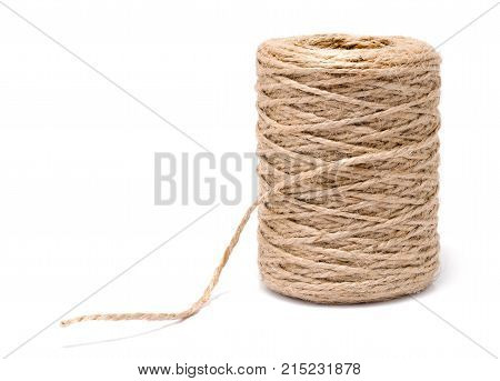 Coil of rope flaxen threads isolated on white background