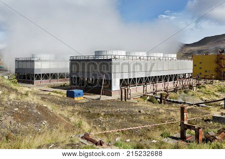 KAMCHATKA PENINSULA RUSSIA - SEP 17 2016: Fan cooling towers of Mutnovskaya Geothermal Power Station (Mutnovskaya GeoPP-1) Geotherm JSC (RusHydro) using geothermal energy to produce electricity.